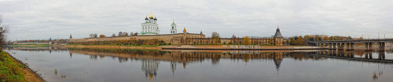 Panoramic view of Pskov Kremlin. Trinity Cathedral in old fortress. Autumn cityscape wide panorama. Royalty Free Stock Image