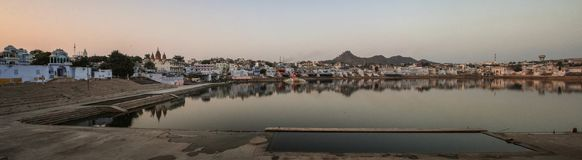 Panoramic view of the Pushkar Lake at sunset, Pushkar, Rajasthan, India. Pushkar is a town bordering the Thar Desert, in the northeastern Indian state of Royalty Free Stock Image