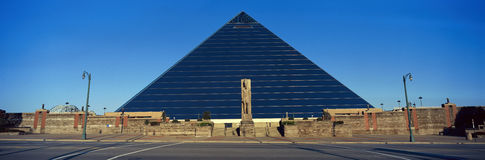 Panoramic view of the Pyramid Sports Arena in Memphis, TN with statue of Ramses at entrance Royalty Free Stock Images