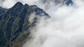 Landscape of mountains and mist. Time Lapse. Panoramic view of the Pyrenees of Andorra with the fast movement of fog stock footage