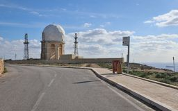 View on the Radar Station `il Ballun near the Dingli Cliffs in Malta on a clear sunny day. Stonewalls in the foreground royalty free stock photography