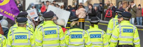 Panoramic view of Rear of Group of Police Officers stock image