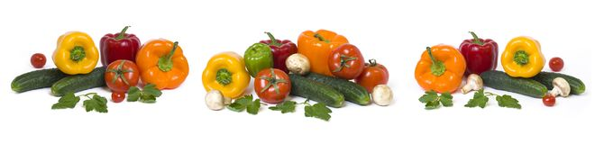 Panoramic view of the red yellow and orange peppers with tomatoes on a white background. Cucumbers with colorful peppers in compos. Ition on a white background royalty free stock photos