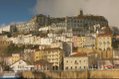 Panoramic view reflected on water. Coimbra. Portugal Stock Images
