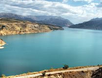 Mountain reservoir with turquoise water. Panoramic view of reservoir with turquoise water, surrounded by scenic mountains royalty free stock photography