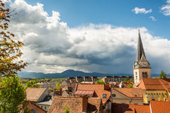 Panoramic view of residential district with a church tower Stock Images