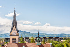 Panoramic view of residential district with a church tower Stock Photos