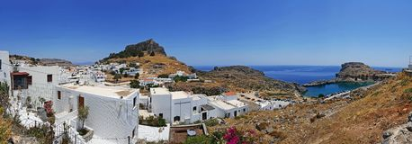 Rhodes Lindos Bay and village. A panoramic view of Rhodes Lindos Bay and village royalty free stock image