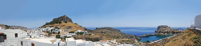 Rhodes Lindos Village an Lindos Castle. A panoramic view of Rhodes Lindos Village an Lindos Castle royalty free stock photography