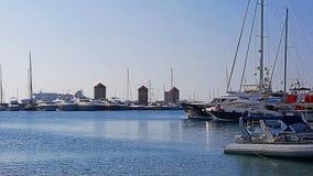 Rhodes Marina Old Windmills. A panoramic view of Rhodes Marina Old Windmills royalty free stock photo