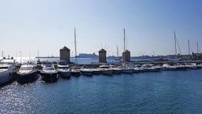 Rhodes Marina Old Windmills. A panoramic view of Rhodes Marina Old Windmills stock photography