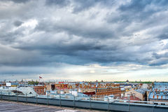 Panoramic view of Riga city, roofs under cloudy sky. Panoramic view of Riga city, roofs under dramatic cloudy sky Royalty Free Stock Images
