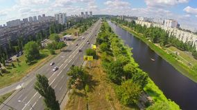 Panoramic view, river and busy street with cars, aerial shot. Stock footage stock video