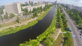 Panoramic view of river channel, cars driving city road, aerial. Stock footage stock footage