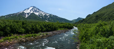 Panoramic view on a river at the foot of Mutnovsky Volcano Stock Photo