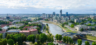Panoramic view of river Neris and high-rise buildings of City on. VILNIUS, LITHUANIA - JULY 10, 2015: Panoramic view of the river Neris and high-rise buildings Royalty Free Stock Image
