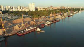 Panoramic view on river port with fleet barges anchored in water next to the river bank. Landscape with great wavy river.  stock video footage