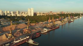 Panoramic view on river port with fleet barges anchored in water next to the river bank. Landscape with great wavy river.  stock video