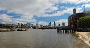 Panoramic view of the River Thames with many of the London landmarks. Panoramic scenic view of the River Thames showing many of the London landmarks, set on a Stock Images