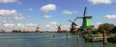 Panoramic view on river and winmills. Royalty Free Stock Image