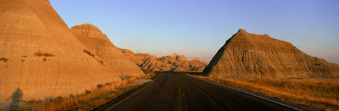Panoramic view of road going through Badlands National Park in South Dakota Royalty Free Stock Photography