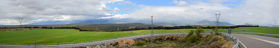 Panoramic view with road, mountains and cloudscape Stock Image