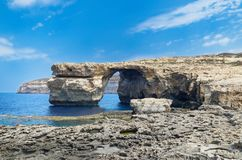 Panoramic view at rock formation Azure Window on Maltese island of Gozo. Panoramic view at rock formation called `Azure Window` on Maltese island of Gozo. This stock photos