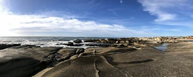 Panoramic view of a rocky beach in Punta del Diablo stock photography