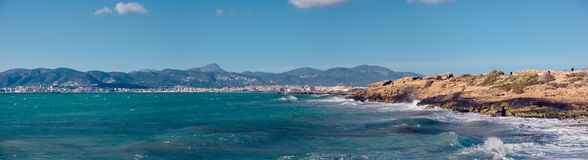 Palma de Mallorca Beach and Sea. The panoramic view on the rocky beach during spring in Pama. Shows the blue sea as well. Perfect place to rest and enjoy the Royalty Free Stock Photo