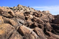 Bushwalking at Yallingup Canal Rocks Western Australia. Panoramic view of the rocky outcrops near Yallingup Western Australia. A tourist couple is seen walking stock image