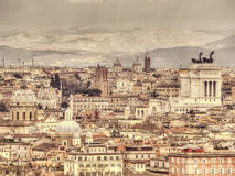 Panoramic view of Rome. Panoramic view of Rome on the background of mountains. Retro toned photo Stock Images