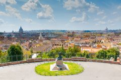 Panoramic view of Rome, Italy. Sunny view of Roman roofs and Saint Peter's basilica , Italy Stock Photo