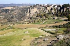 Panoramic view upon Ronda surrounding plains fields Stock Photo