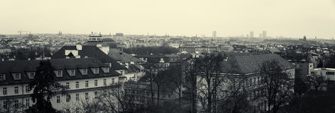 Panoramic view of the rooftops of old Prague. Sepia. Stylized film. Large grains Royalty Free Stock Images