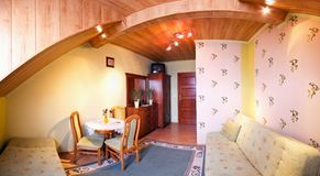 Panoramic view of room in loft  Royalty Free Stock Photos