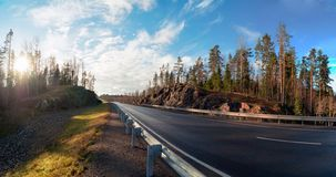 Panoramic view of the route A-121 Sortavala in Karelia. Russia. Autumn landscape highway A-121 Sortavala in Karelia. Russia stock image