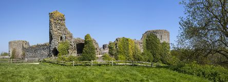 Pevensey Castle in East Sussex. Panoramic view of the ruin of Pevensey Castle in East Sussex, UK. It is a medieval castle and former Roman Saxon Shore fort royalty free stock images