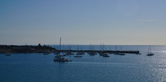 Panoramic view of sailing boats on sea stock images