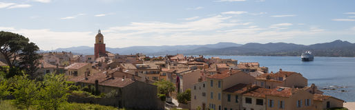 Panoramic view on Saint Tropez France and its bay. A cruise ship is anchored in the bay Stock Image