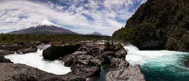 Panoramic view of Saltos del Petrohue waterfalls and Osorno Volcano in Vicente Perez Rosales National Park, Chile royalty free stock image