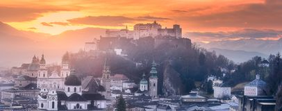 Panoramic view of Salzburg at winter morning. Panoramic view of Salzburg and Kapuzinerberg hill at winter morning sunrise, Austria Stock Photos