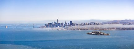 Panoramic view of San Francisco`s skyline and Alcatraz Island on a sunny day, California stock photography