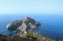 Panoramic view of San Juan de Gaztelugatxe islet. Panoramic view of Bizkaia coast, with San Juan de Gaztelugatxe islet and his ancient hermitage, in Spain Stock Photos
