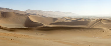 Panoramic view of sand-dunes in the Sossusvlei Nature Reserve in Namibia.  These reddish dunes at the main `vlei` salt pan are m Royalty Free Stock Image