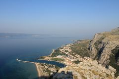 Panoramic view of the sandy beach of Omis Croatia from the high mountain stock photo