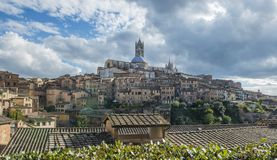 Panoramic view of Santa Maria catedral,Siena. Tuscany, Italy with dramatic cloudy sky, day time Stock Image