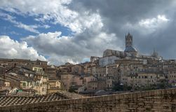 Panoramic view of Santa Maria catedral,Siena, Tuscany, Italy. With dramatic cloudy sky, day time Royalty Free Stock Image