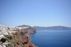 Panoramic view, Santorini island, Traditional and famous white houses and churches with blue domes over the Caldera, Aegean sea. Panoramic Santorini island stock image