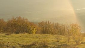 Panoramic view of the scenic autumn valley from a steep bushy slope on sunset sky background. Shot. Spectacular mountain. Panoramic view of the scenic autumn stock video footage