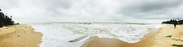 A panoramic view of the scenic Kodi Beach. A panoramic and scenic view of the Kodi Beach, with foamy waters and silvery sand Stock Images